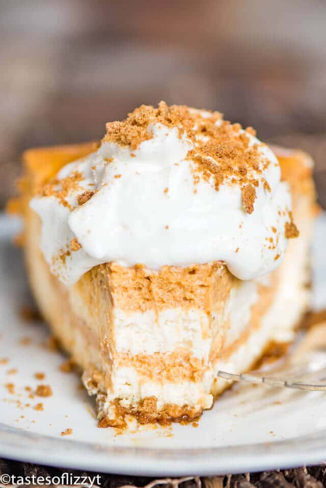 Treat your holiday guests to this Pumpkin Swirl Cheesecake recipe with gingersnap crust! A make ahead dessert perfect for entertaining.