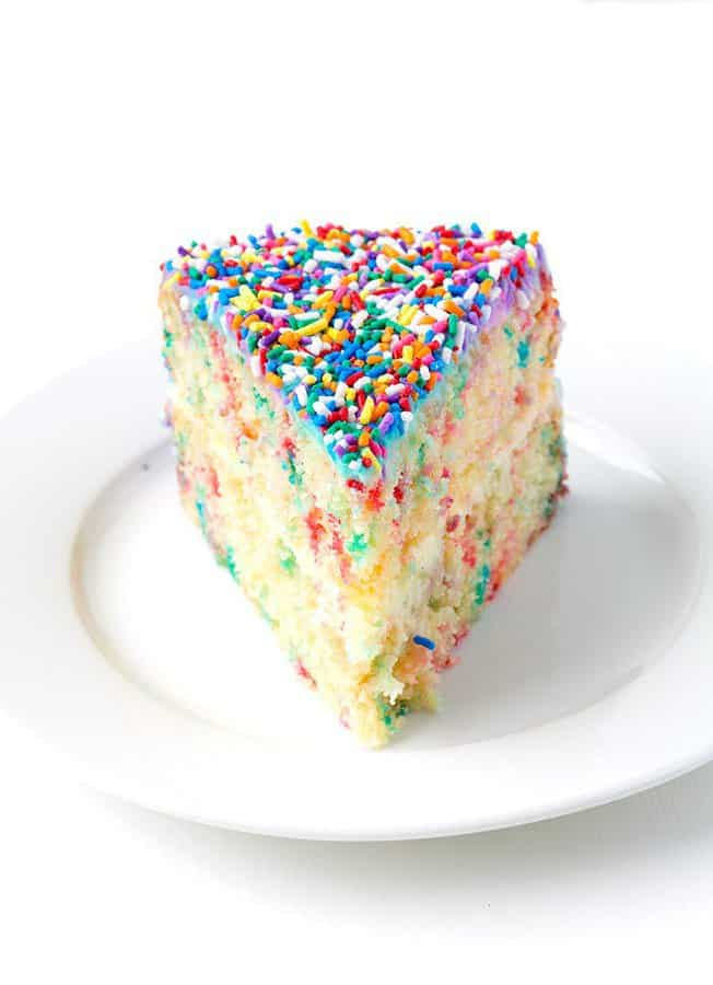 Not only is this cake a total showstopper but one bite, and you'll be in funfetti cake heaven! Sprinkle lovers unite!
