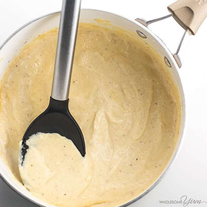 This low carb keto Alfredo sauce is easy to make - just 10 minutes and 4 common ingredients! It will be your favorite garlic Parmesan cream sauce recipe.