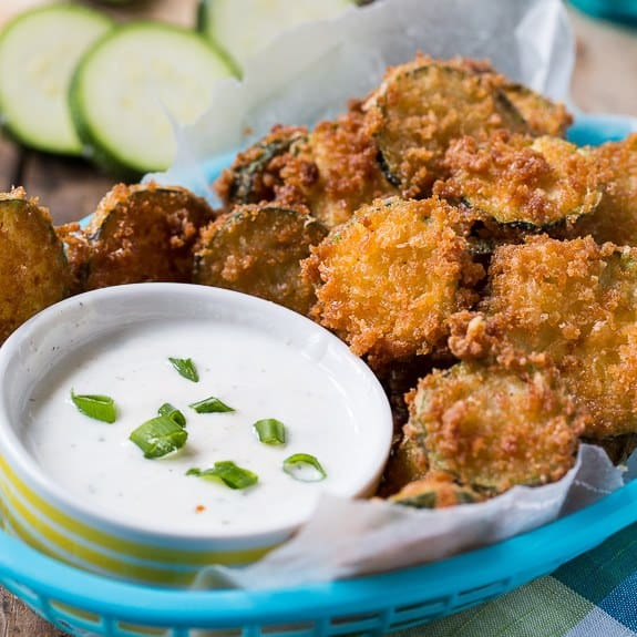 Super Crispy Zucchini Chips favored with a little Parmesan cheese are a great way to use up summer zucchini. Serve with some Ranch for dipping and you have a mouthwatering snack or appetizer.