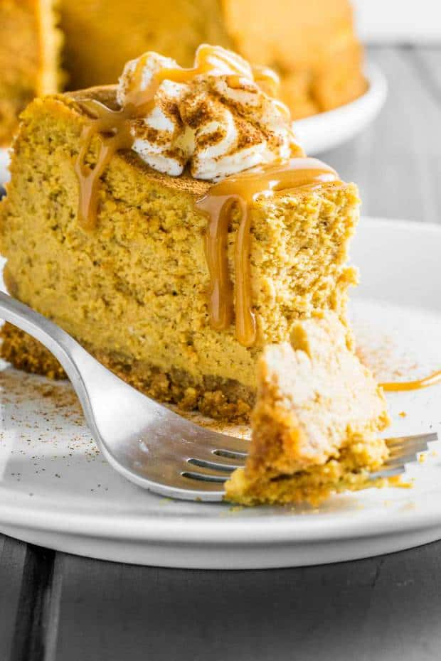 Classic cheesecake infused with creamy pumpkin, plus a double dose of pumpkin spice - it's baked both in the cake and the crust!