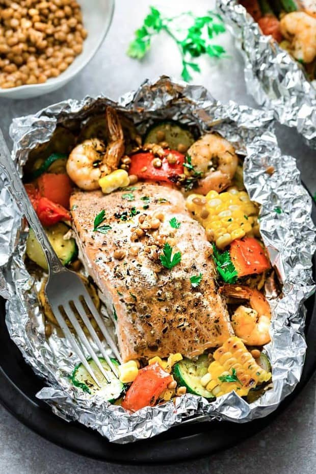 This recipe for Mediterranean Salmon Foil Packets with Lentils is a quick, healthy and tasty 30 minute meal. Best of all, can be baked or grilled with summer veggies and protein-packed lentils. These are perfect for busy summer nights, camping and cookouts.