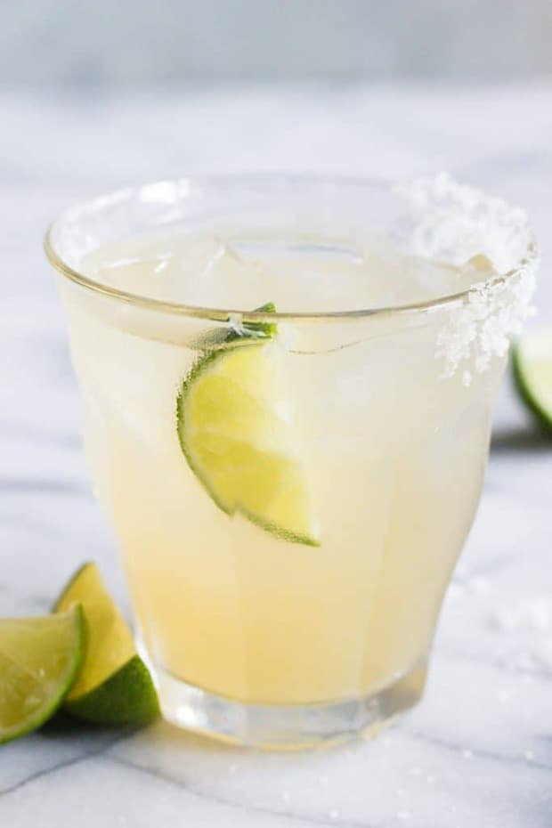 Enjoy the refreshing taste of this classic margarita made with simple ingredients. No mix required! This simple margarita recipe is sure to become your favorite! Made with fresh lime juice, agave to sweeten, and a combination of tequila and triple sec. This cocktail is easy to make at home!