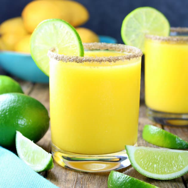 The Smoky Mango Margarita – your new favorite sipping sensation! It's a little sweet from the mango, tart from the fresh lime juice, and earthy/smoky from the tequila and mezcal. The perfect libation for your next soiree!