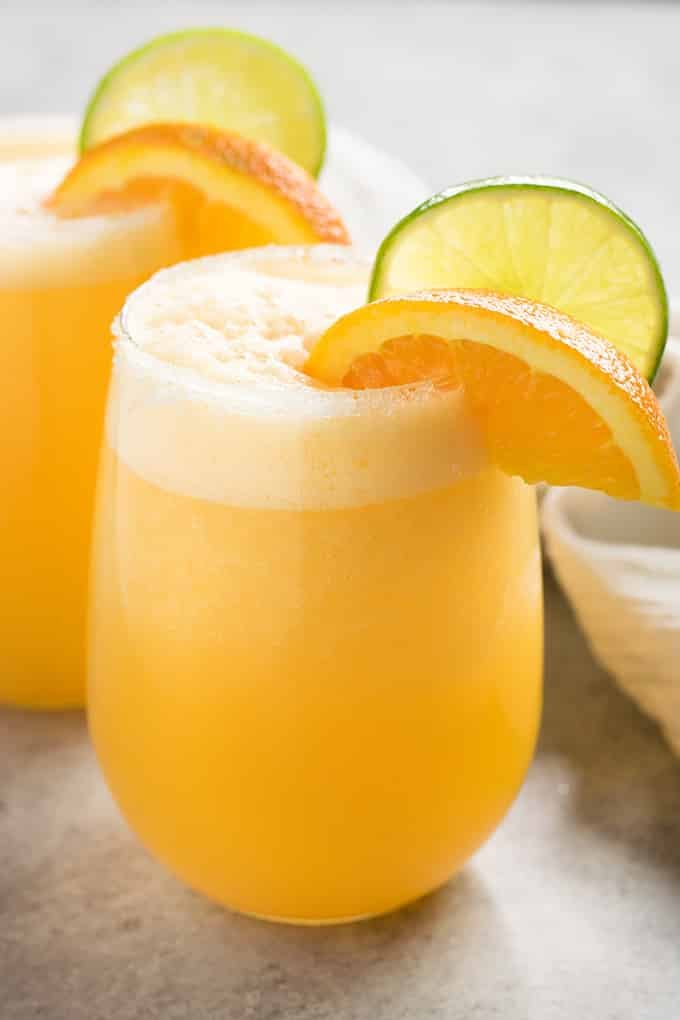 Frosty Orange Margaritas – A sweet change up to traditional margaritas! These orange margaritas are super quick and easy to make, perfectly sweet with fresh orange juice, and amazingly refreshing.