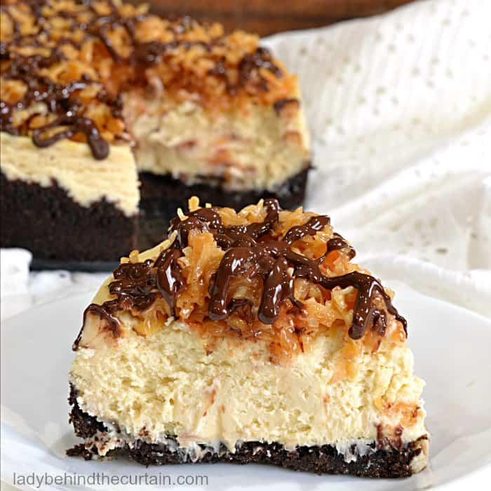 """Inspired by your favorite Girl Scout cookie """"Caramel DeLites"""". This vanilla based cheesecake has a chocolate crust with a simple to make caramel coconut topping and a drizzle of chocolate. It doesn't get any better than that."""
