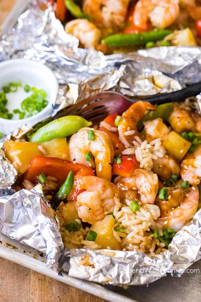 When the temperature rises, easy meal prep and even easier clean up is my kind of meal! Teriyaki Shrimp Foil Packets taste light and fresh! This is truly the perfect summer meal! Simple, tasty and the perfect family dinner!