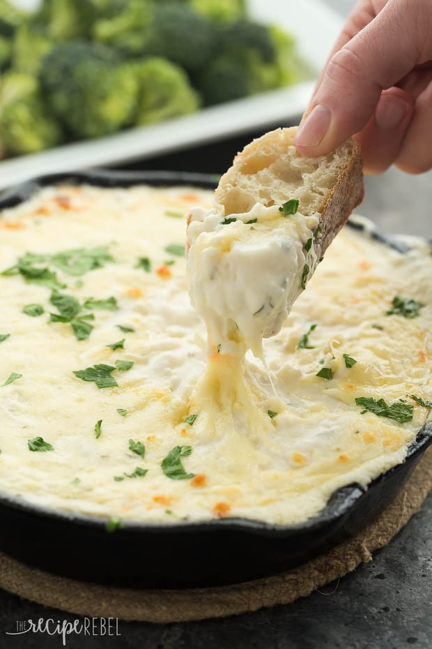This Chicken Alfredo Dip is out of this world! It's creamy, cheesy, loaded with chicken and made from scratch! Perfect as an appetizer or a casual lunch or dinner