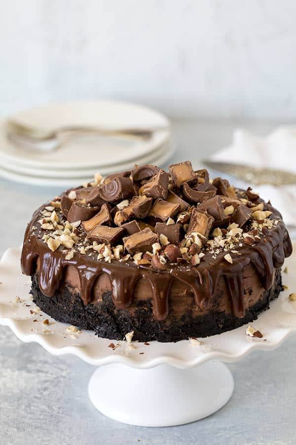 Nutella Rolo cheesecake is  rich, creamy, decadent Nutella cheesecake topped with chocolate ganache, Rolo candies, and chopped hazelnuts. This Insta Pot Nutella Rolo Cheesecake recipe is easy-to-make and ridiculously delicious! One of the most decadent pressure cooker cheesecake recipes I've made!