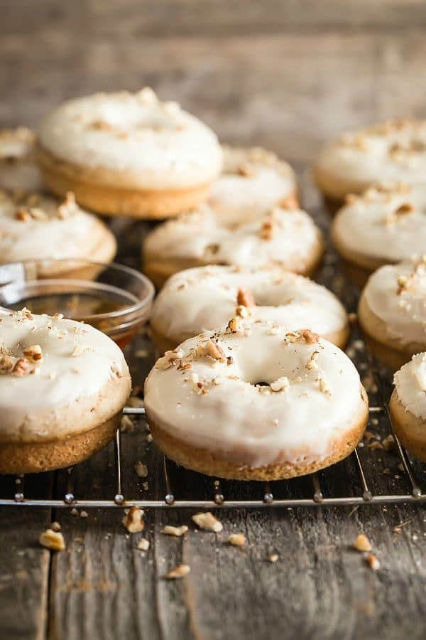 Maple Pecan Baked Donuts are to die for! The frosting needs its own podium. Powdered sugar is mixed with vanilla, milk and maple syrup.