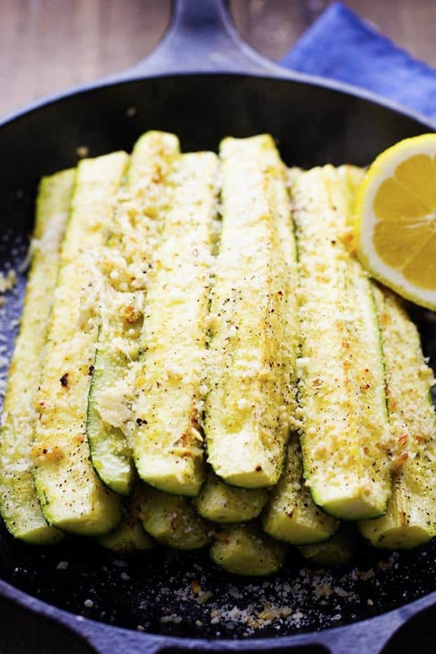 Quick and easy zucchini spears that are coated in parmesan and garlic and roasted in the oven to perfection. It is delicious and the perfect way to use up that zucchini!