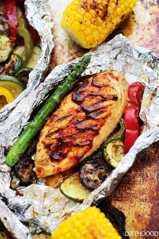 Grilled Barbecue Chicken and Vegetables in Foil - tender, flavorful chicken covered in sweet barbecue sauce and cooked on the grill inside foil packs with zucchini, bell peppers and asparagus. Delicious, tasty and no mess!