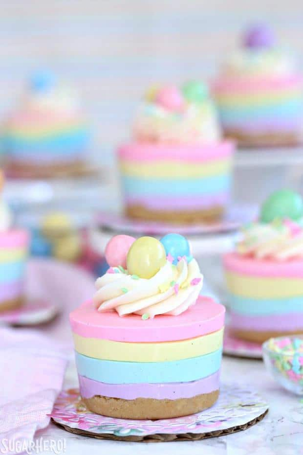 Looking for an easy Easter dessert? These Easter No-Bake Mini Cheesecakes are perfect! They're cute pastel striped cheesecakes that are simple to make, no baking required!