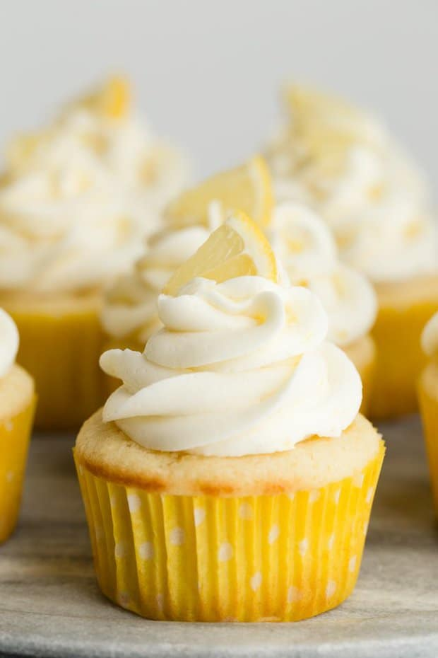 Lemon Cupcakes filled with lemon curd and topped with lemon buttercream frosting. These Lemon filled cupcakes remind me of lemon drop candies, so sweet and tangy!