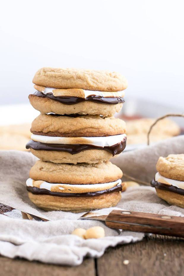 Transform a campfire classic with these peanut butter s'mores cookies! soft & chewy sandwich cookies with a rich chocolate ganache and toasted marshmallow fluff.