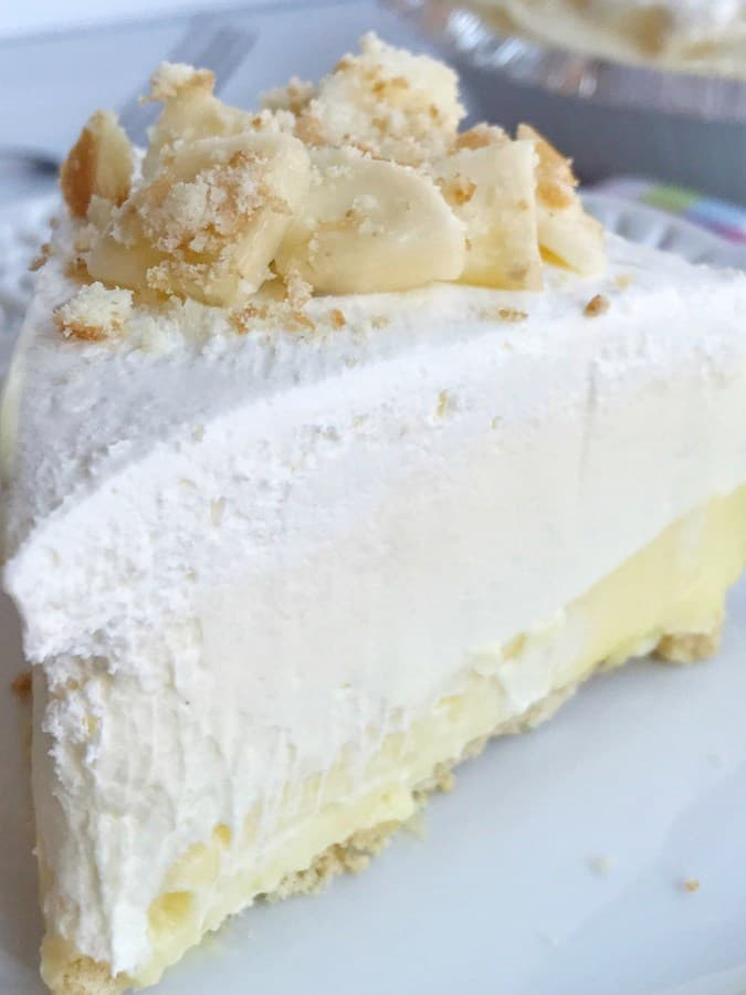 TrTriple layer banana pudding cheesecake pie is a no bake dessert that is so creamy delicious and tastes just like banana pudding! If you're not a fan of brown bananas in traditional banana pudding then you will love this! Perfect for an easy dessert or the Thanksgiving dessert table