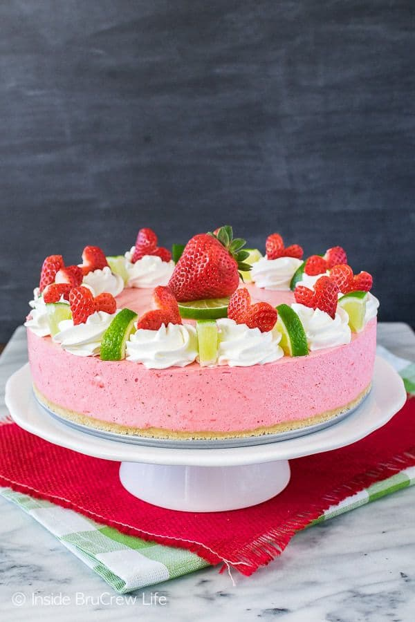 This easy No Bake Strawberry Daiquiri Cheesecake is a refreshing dessert to enjoy on a hot summer day. Strawberry and lime pair so well in this light fluffy mousse