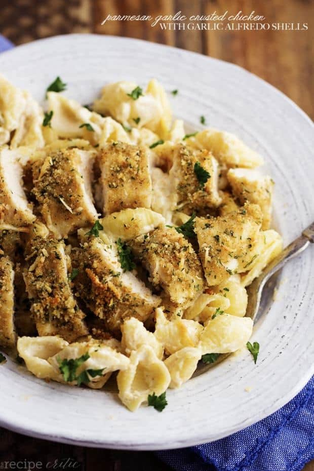 The most creamy and delicious homemade garlic alfredo shells topped with crispy parmesan garlic chicken.  This is an absolutely fantastic meal that will instantly become a family favorite!