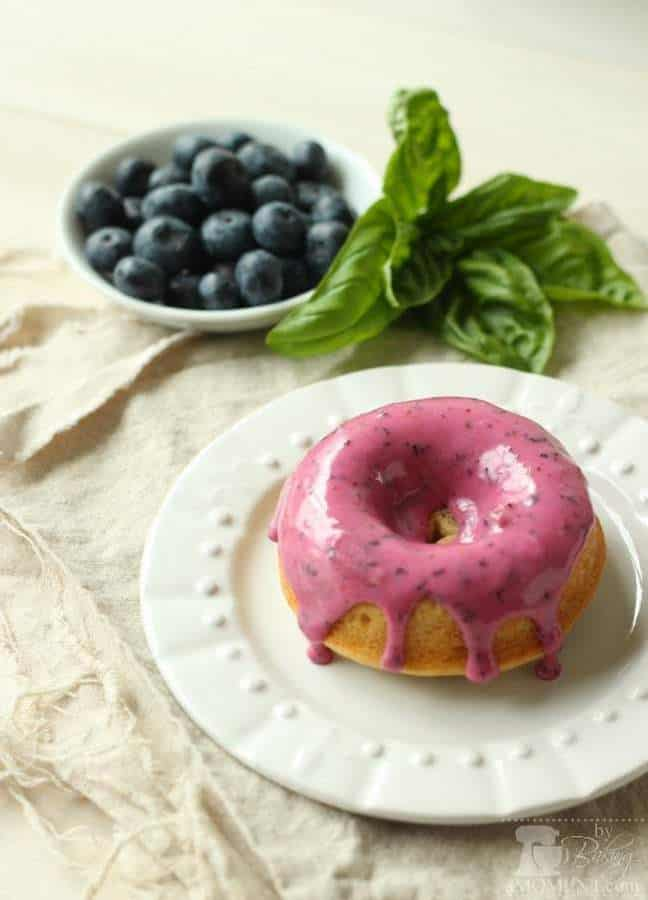 Bake up a special Breakfast Treat for your loved ones today to Baked Blueberry Sour Cream Donuts! Tender Sour Cream Donuts with Summer's Best Blueberries Baked in, and a gorgeous Blueberry Glaze! Try adding a little Fresh Basil from your Garden for a Subtle hit of Herbal Freshness. Your family will love these Soft Cake Donuts, Studded with Pockets of Jammy Blueberries!