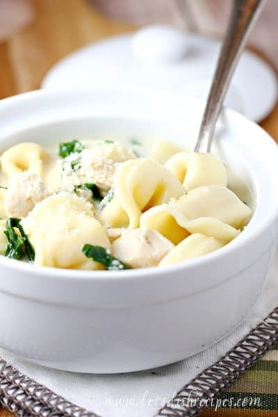 CHICKEN TORTELLINI ALFREDO SOUP — This hearty soup features cheese tortellini, chicken and fresh spinach. because of this it is a heartwarming meal that's ready in 20 minutes!