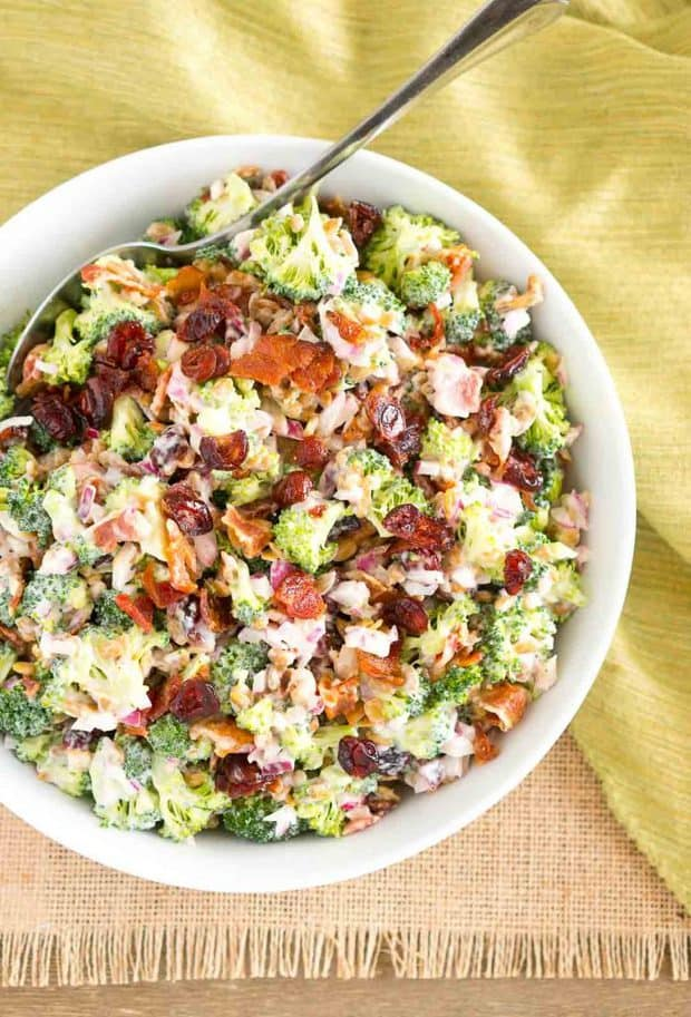 This Broccoli Salad is a party or potluck favorite. It's dressed in a creamy dressing and it's made with bits of salty bacon, tangy red onion, sweet craisins and crunchy sunflower seeds. This salad is so delicious and the dressing pairs wonderfully with the salad.