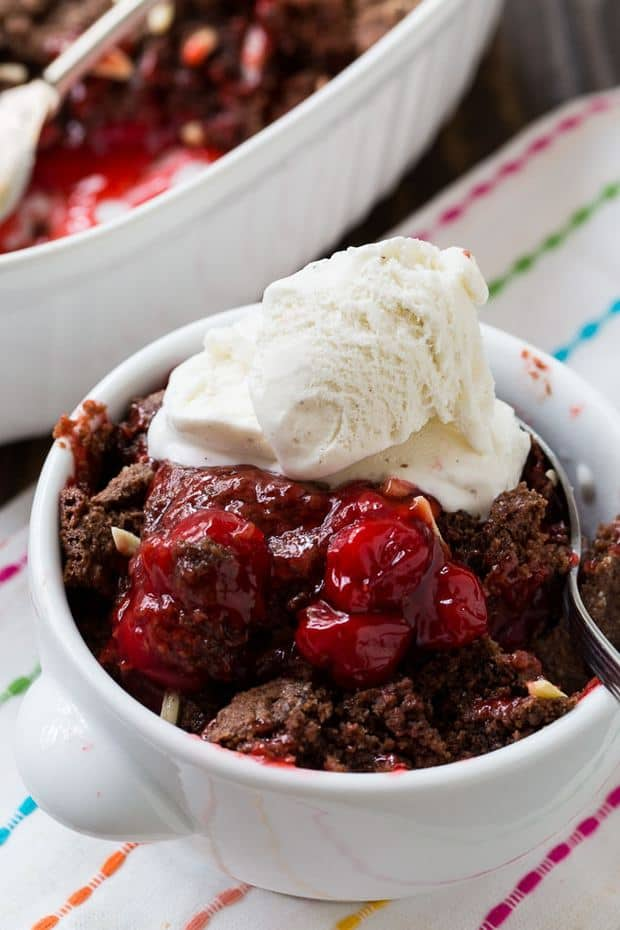 Cherry Chocolate Cobbler is a Cracker Barrel knock-off and it's the perfect ending to a country meal. You're going to want to get out the vanilla ice cream for this one y'all. Serve it warm with a nice big scoop of ice cream and you will be in heaven.