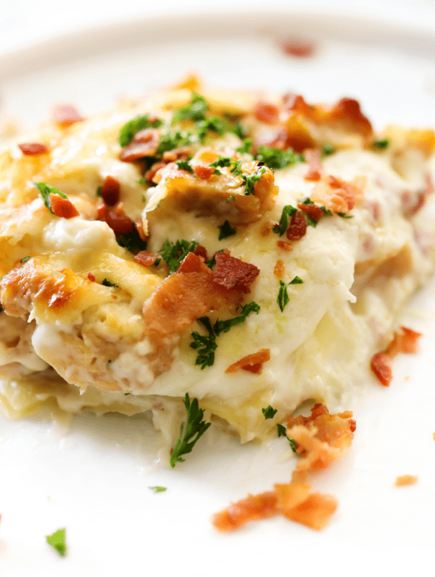 This Chicken Cordon Bleu Lasagna will quickly rise to the top your family's favorite dinner list! It is hearty and is jam packed with wonderful flavor. How can one go wrong with bacon though?! With layers of pasta, cream cheese sauce, ham, chicken and bacon- this dinner will be unforgettable! I know you will love this as much as we do!