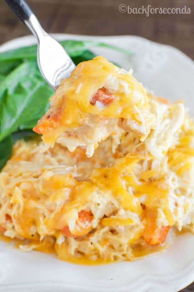 ThisEasy Cheesy Crock Pot Chickenrecipe fromBack for Secondsis a no fuss dinner that your family will really love! It's filled with hearty, creamy, cheesy ingredients that even the most picky of eaters will eat right up — and best of all, it makes the perfect go-to meal for busy weeknights!