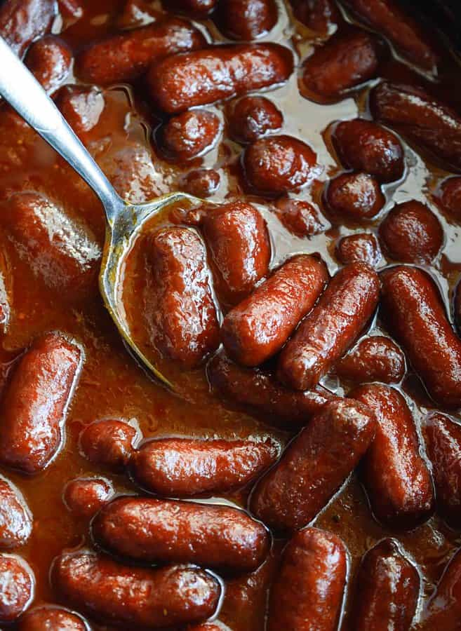 Apple Barbecue Slow Cooker Little Smokies are the perfect holiday appetizer! Mini sausages cooked in your crockpot and slathered with a mild, sweet sauce.
