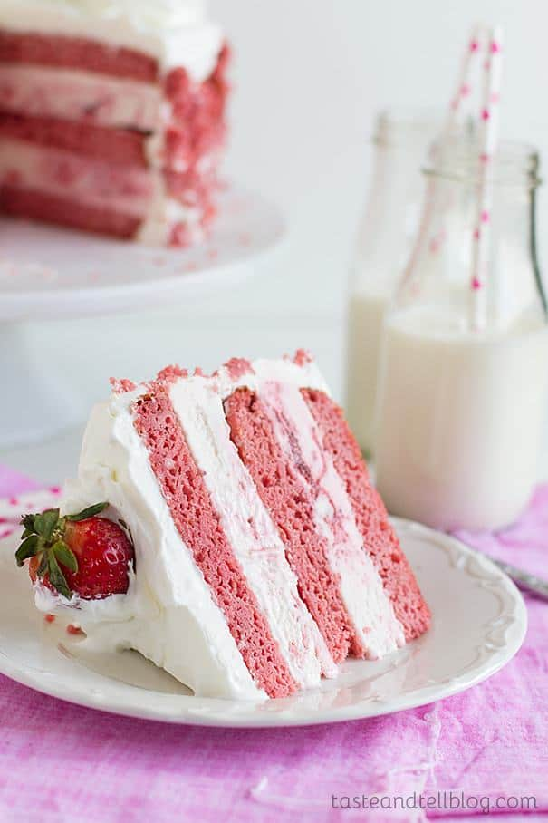 Layers of strawberry cake are sandwiched with strawberry ice cream and frosted with sweetened whipped cream for a delicious and fun Strawberry Milkshake Ice Cream Cake.
