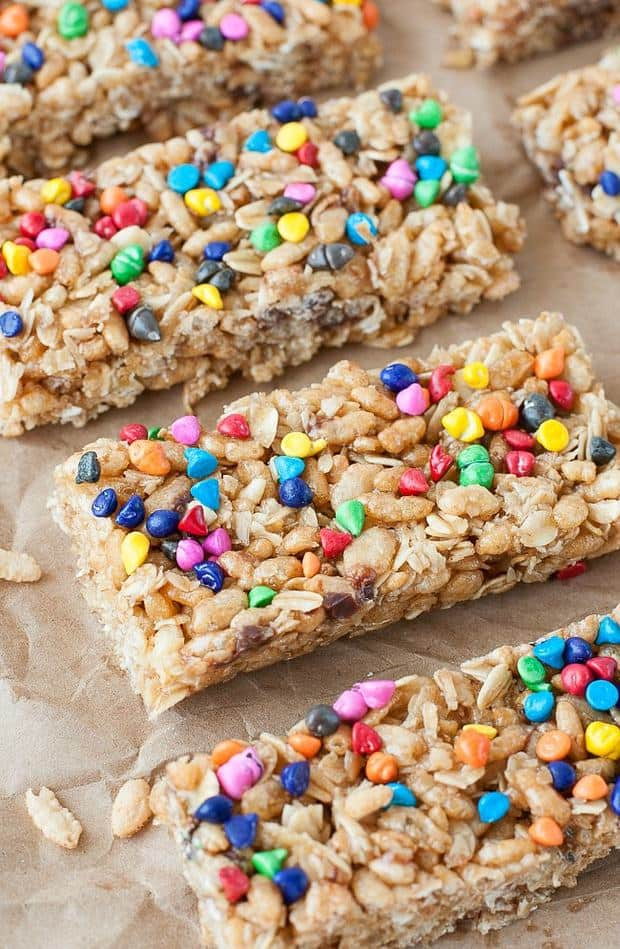 Skip the box and whip up a batch of delicious granola bars at home! These chewy rainbow chip granola bars are so quick and easy, they're as much fun to make as they are to eat!