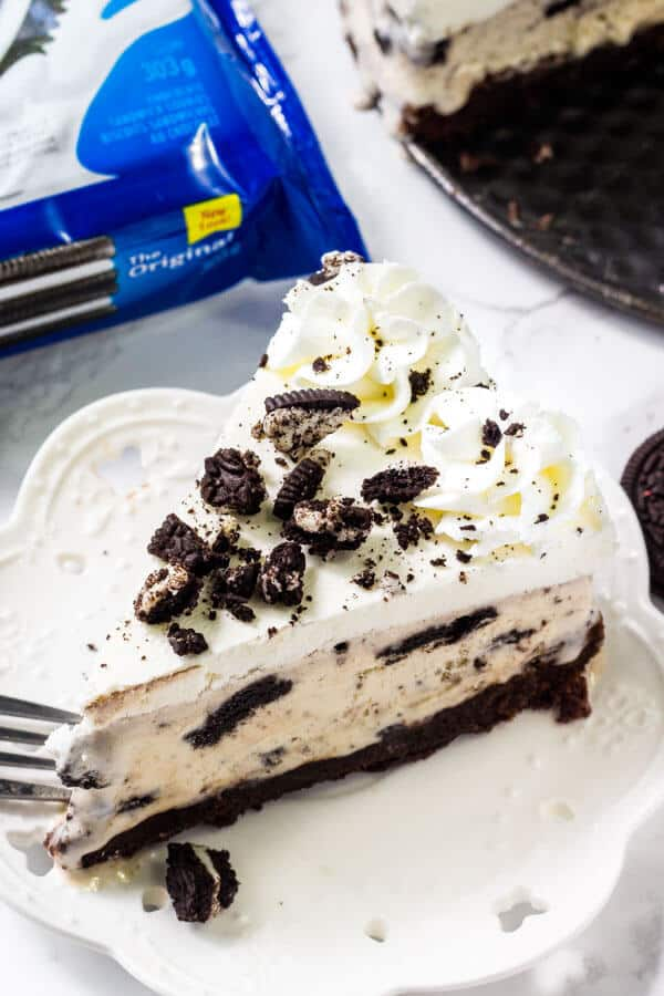 Mocha Brownie Ice Cream Cake – Layers of delicious brownie, coffee cream cheese, coffee ice cream, and whipped topping.  If you love an iced mocha frappe, then you will love this dessert!