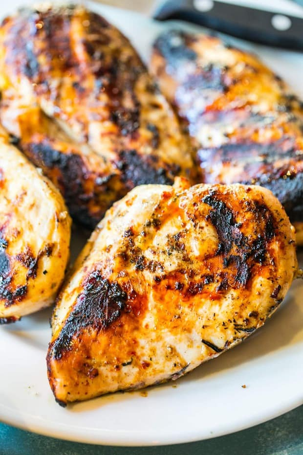 Delicious, never-dry juicy and flavorful Perfect Grilled Chicken Breasts are perfect for cookouts and picnics – or even chopped up cold for a sack lunch! These chicken breasts are juicy, tender, and full of smoky, earthy flavor everyone begs for again and again.