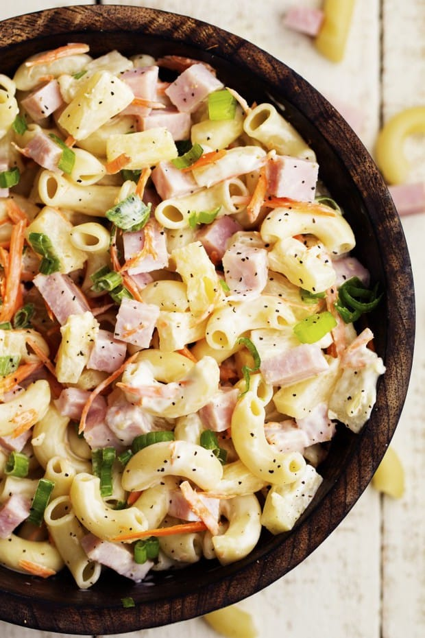 A delicious Hawaiian Macaroni Salad with ham, pineapple, shredded carrots, and green onions. It has such amazing flavor and it coated in a sweet and tangy pineapple dressing.