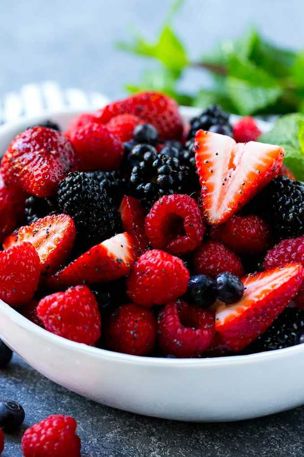 THIS BERRY FRUIT SALAD IS A COMBINATION OF BLUEBERRIES, STRAWBERRIES, RASPBERRIES AND BLACKBERRIES, ALL TOSSED IN AN EASY HONEY LIME POPPY SEED DRESSING. THIS BERRY SALAD IS A MUST-MAKE FOR ALL YOUR SUMMER CELEBRATIONS!