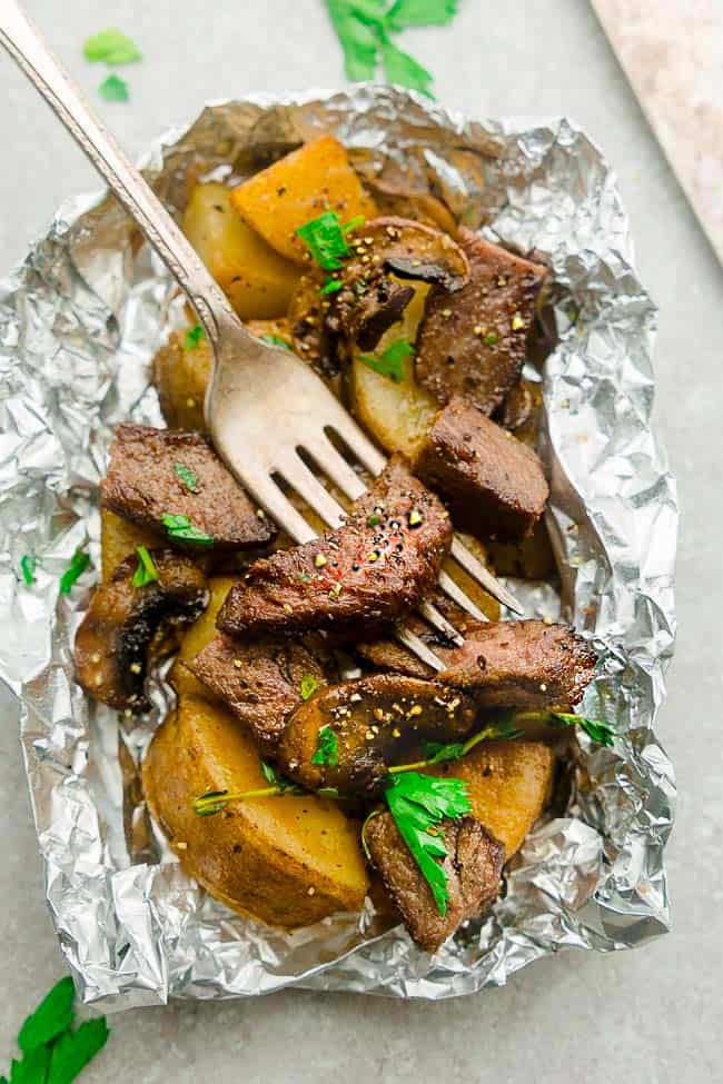Steak and Potatoes Foil Packets are full of flavor with mushrooms, garlic, butter, herbs and perfect for busy weeknights. Best of all, instructions to make these in the oven and the grill.