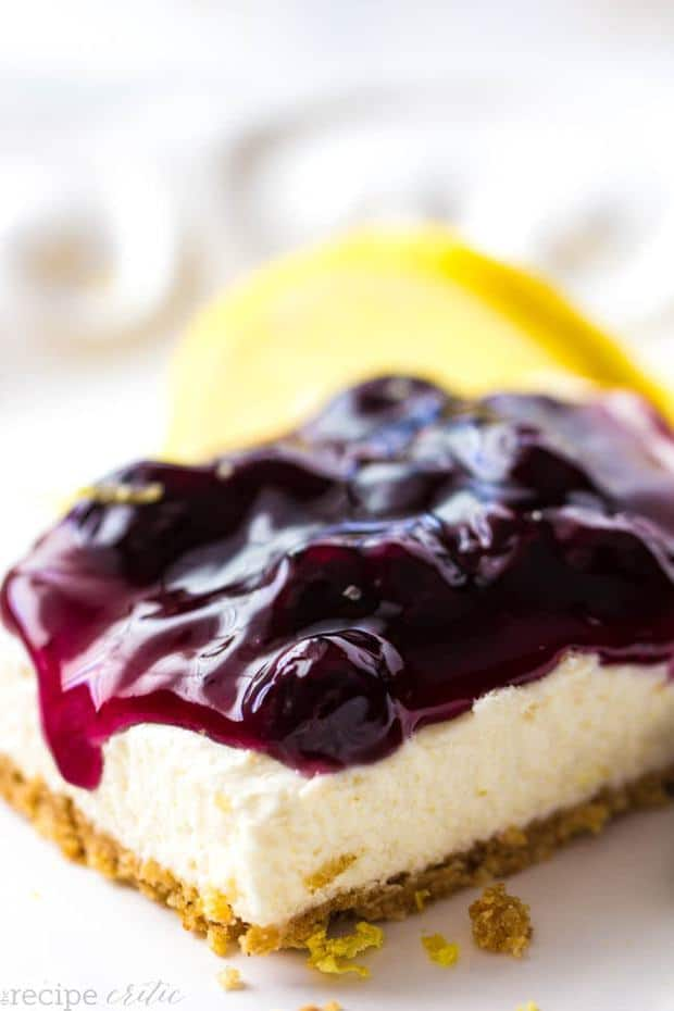Delicious and creamy lemon no bake cheesecake bars with Lucky Leaf Blueberry topping!