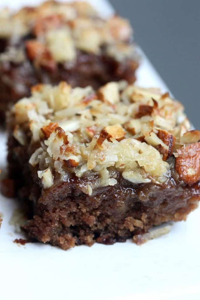 Grandma's Oatmeal Cake is made with rolled oats and topped with a mixture of shredded coconut and slivered almonds.