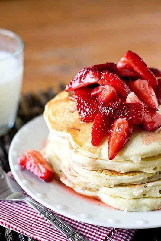 Classic, fluffy pancakes with strawberries and sugar streusel baked inside. Serve these Strawberry Shortcake Pancakes with macerated strawberries for a unique, irresistible breakfast!