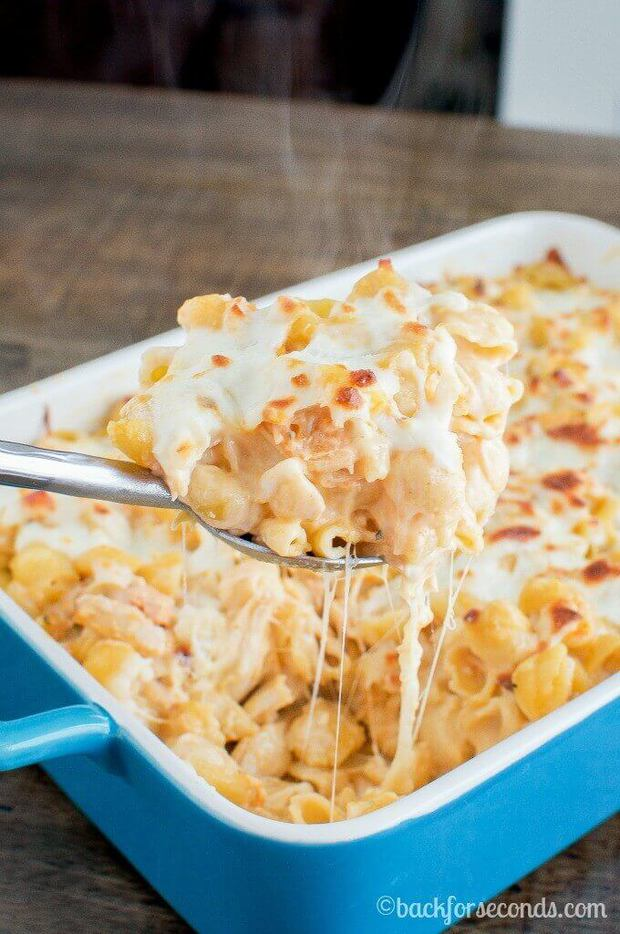 This Buffalo Chicken Alfredo Bake recipe from Back for Seconds is a quick and easy dinner thatyour family is really going to love. It's a delicious spicy, cheesy casserole that is perfectfor busy weeknights. It's a comfort food recipe that you'll definitely want to put on your regular dinner rotation!