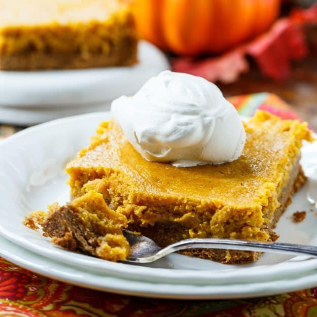Pumpkin Spice Gooey Butter Cake tastes almost just like pumpkin pie but it is so much easier to make and feeds more people
