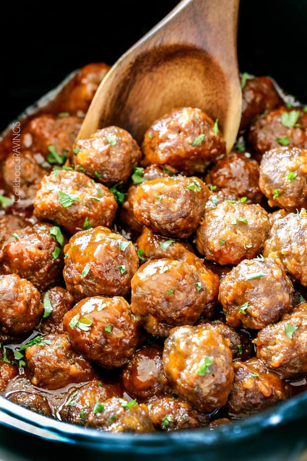 Tender, juicy Slow Cooker Honey Buffalo Meatballs simmered in the most tantalizing sweet heat sauce that everyone goes crazy for! Perfect appetizer or delicious, easy meal!