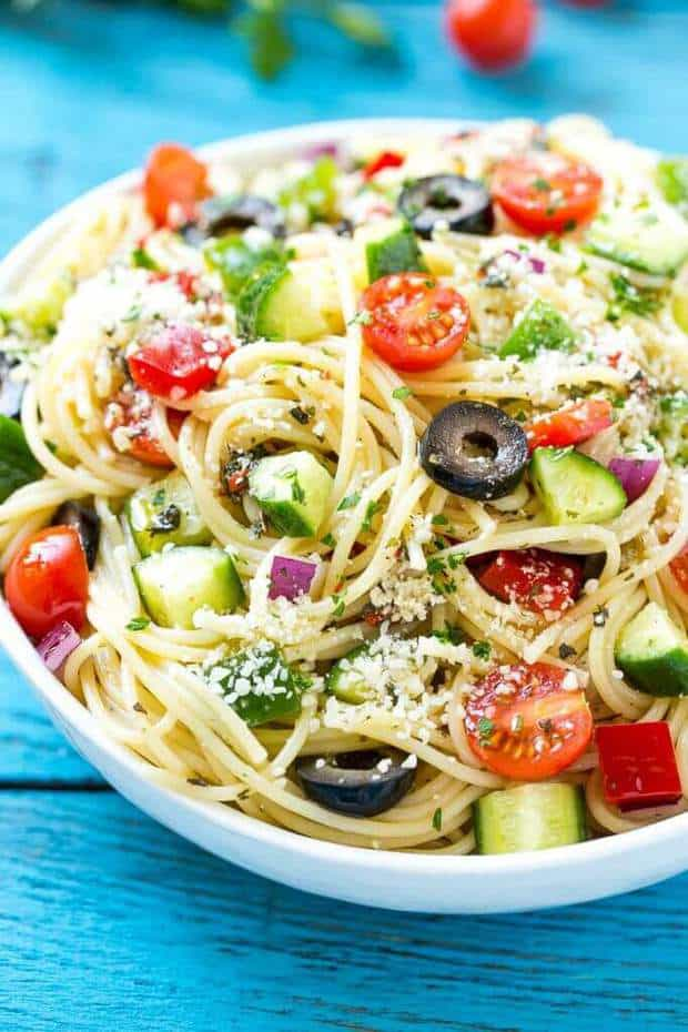 This amazing salad is the most delicious pasta salad filled with your favorite fresh vegetables that get tossed in Parmesan cheese and a Homemade Zesty Italian dressing.