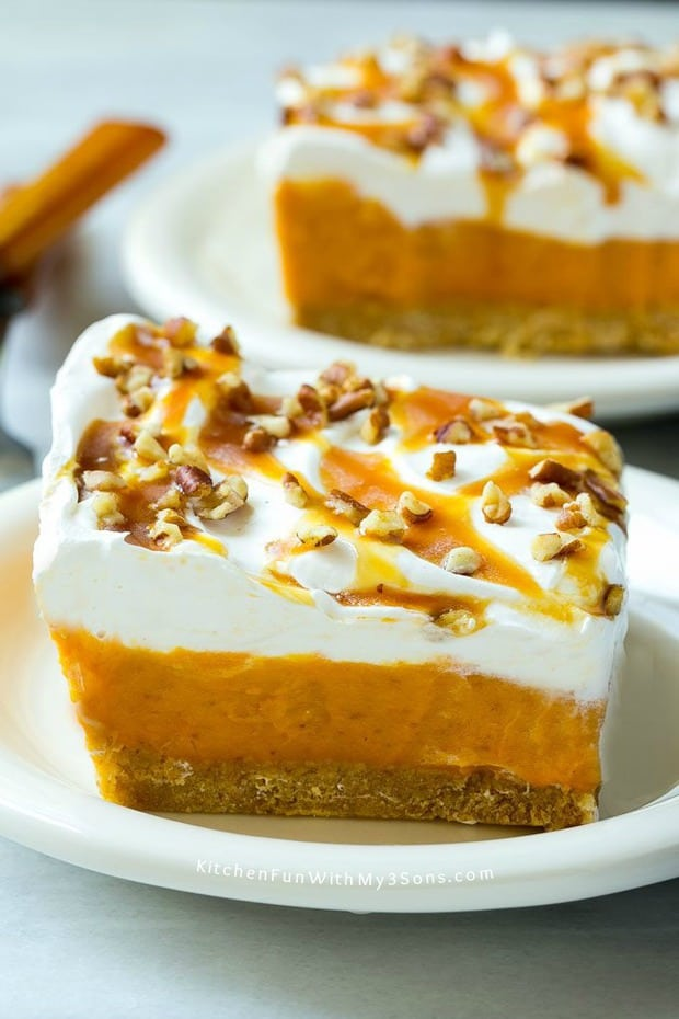 No-Bake Pumpkin Lush Dessert is layers of graham cracker crust, pumpkin pudding and whipped topping, all topped with caramel and pecans. The ultimate fall dessert!