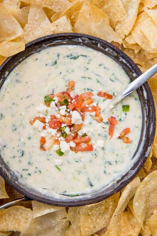 Chili's White Spinach Queso made with fresh spinach and three cheeses served in a still warm skillet in just 10 minutes! The perfect appetizer recipe your whole family will love.
