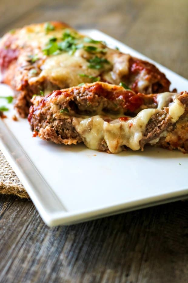This Pizza Loaf tastes nothing like traditional meatloaf but just like pizza and is sure to be a hit with your family as much as it is with mine!