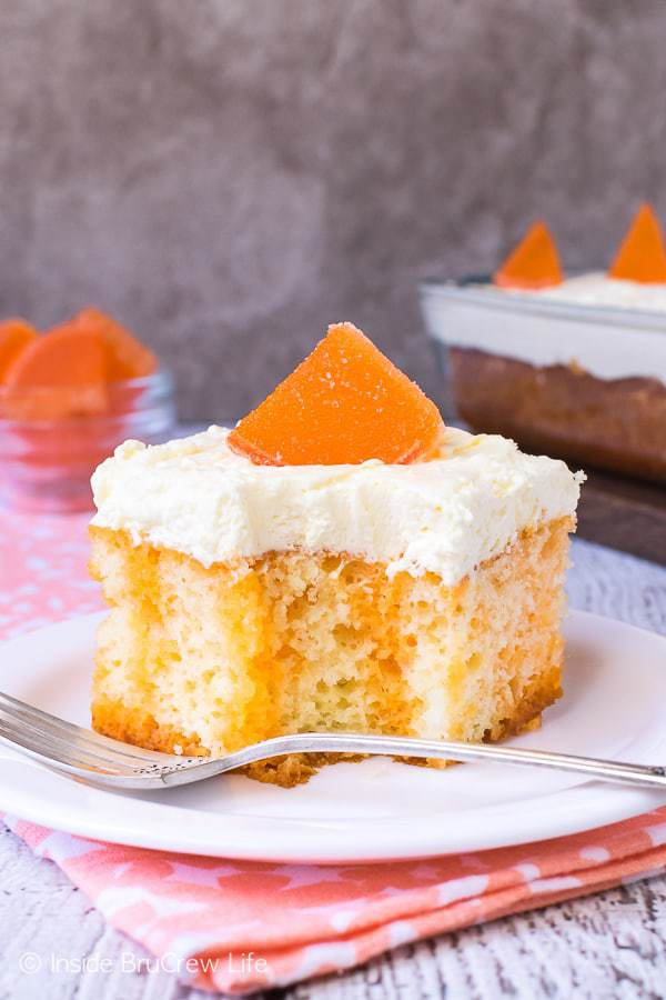 This Orange Creamsicle Poke Cake is the perfect summer dessert.   This cool, creamy and delicious cake will not last long when you share it at parties or picnics this year.
