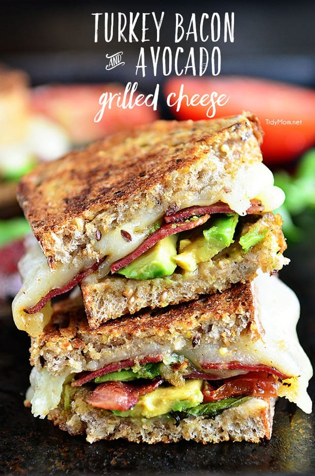 A fancy twist on a grilled cheese. Turkey Bacon and Avocado Grilled Cheese grilled until golden and gooey loaded with fresh basil, tomatoes and mozzarella cheese on a hearty artisan bread.