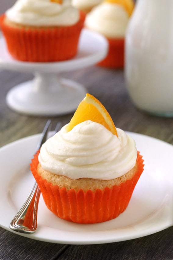 Orange Creamsicle Cupcakes are loaded with orange flavor and are topped with cream cheese frosting. With a gluten-free option.