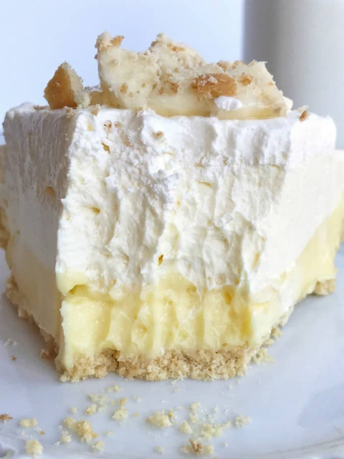 This no bake Triple Layer Banana Pudding Cheesecake Pie from Together As Family is so creamy and delicious and tastes just like banana pudding! It's perfect for an easy Thanksgiving dessert.